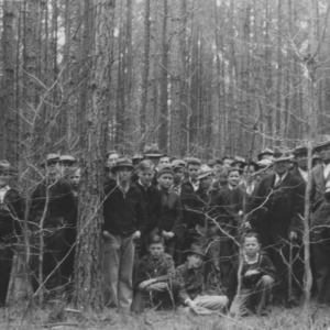 Farmers and vocational students at a forestry meeting and demonstration at farm of J.C. Chewning, Anson County