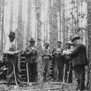 M.L Efird and a goup of his neighbors at a timber thinning demonstration