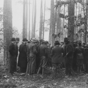 Farmers and vocational agricultural students at a demonstration of cutting for fuelwood and tobacco wood