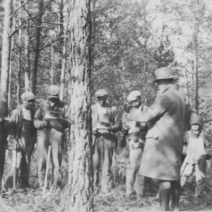 Extension Agent J.W. Jeffries conducting a class in Wood-cutting and Timber Thinning