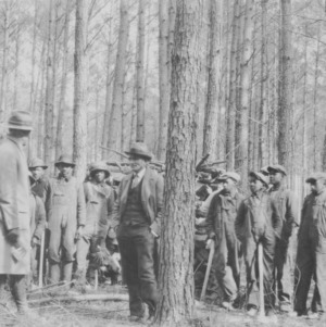 "J.B. Britt, county agent, conducting a class in ""wood-cutting and timber thinning"" at the farm of Turner Whitehead, Halifax County"