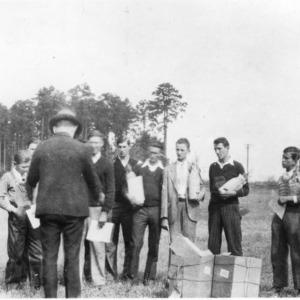 W. G. Yeager distributing walnut seedlings to 4-H club members