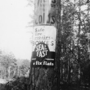 Road-side advertisement unlawfully placed on timber