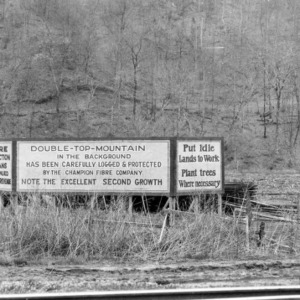 Billboard sign notifying logging of Double-Top-Mountain