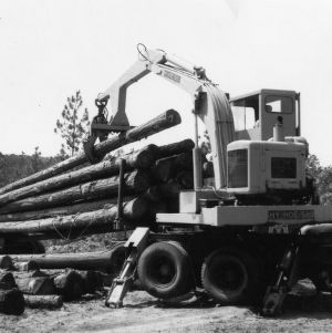 Excavator lifting logs