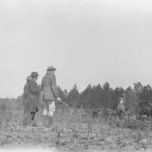 Plowing terraces by members of first terracing school in North Carolina