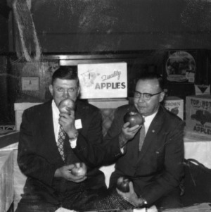 Extension Director D. S. Weaver and former N. C. Apple Growers Association president Everett Lutz with apples