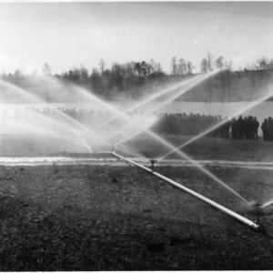 Farmers observing irrigation system demonstration