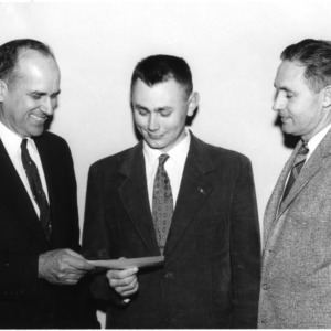 Joe Sugg presenting check to James M. McGuire and Dr. R. L. Lovvorn