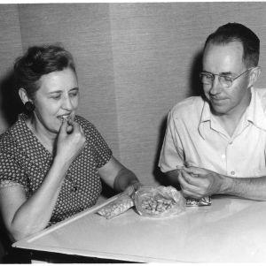 """Man and woman eating """"atomic"""" peanuts"""