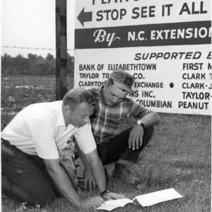 Jack Cullipher and George Harrelson examining peanut test description