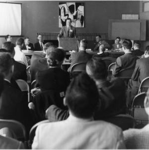 Man at Farm Press, Radio, and Television Institute Meeting