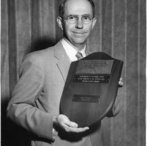 A. D. Stuart with award