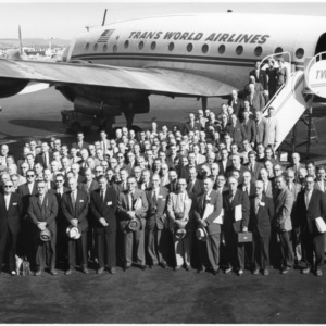 Large group of the Farm Opportunities and Marketing Caravan in front of TWA airplane