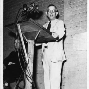 I. O. Schaub speaking at podium
