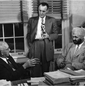Major Harpel Singh Sandu meeting with Dr. I. O. Schaub and Ford M. Milam to discuss India's first land grant college