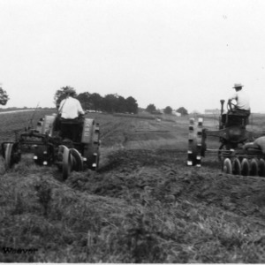 Tractors Plowing and Disking Field