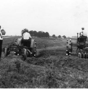 Tractors with Plowing Discs in Field