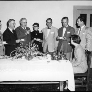 Group at refreshments table, Farm Press and Radio Institute