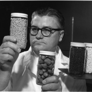 N.C. State University Food Scientist, M.W. Hoover, examining freeze-dried fruit