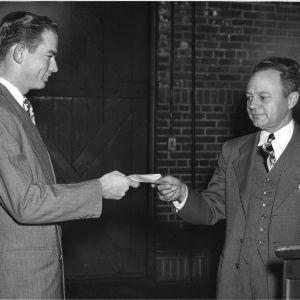 Rufus Warren, President of NC Future Farmers of America, presenting check to R.J. Peeler, FFA's executive secretary
