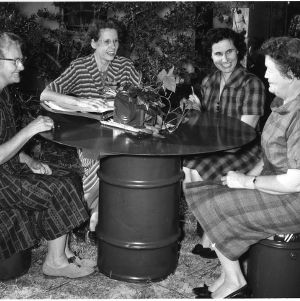 Four members of the Ashemont Home Demonstration Club using their homemade outdoor furniture