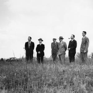 Men standing on original Mangum Terrace at historical marker dedication