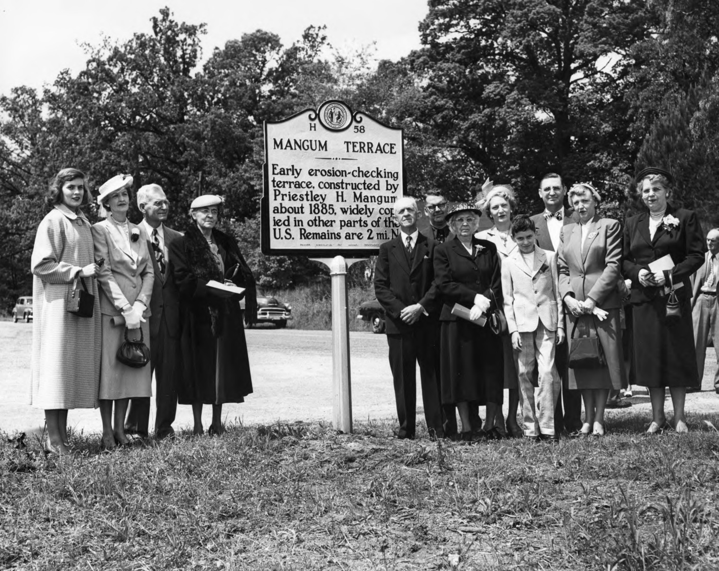 Mangum family around Mangum Terrace Historical Marker