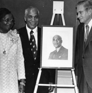 George Hyatt with couple and portrait