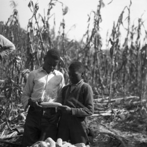 Absenia Johnson and Aron Johnson with corn