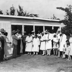 African American extension agent giving demonstration in poultry, 1928