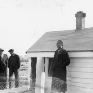 Men and women outside building, African American Farm Tour