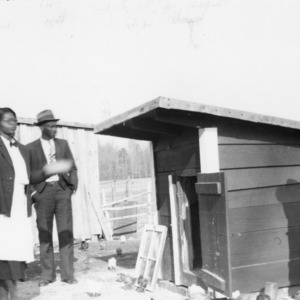 Woman and men outside chicken coop, African American Farm Tour