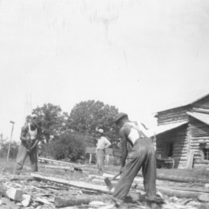 Charles Cates, fixing logs for new [bruted?] house