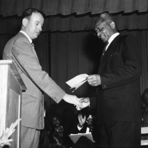 William Poe presenting check to Dr. W.T. Gibbs