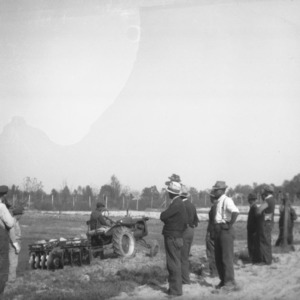 Farmers Watching Tractor Demonstration
