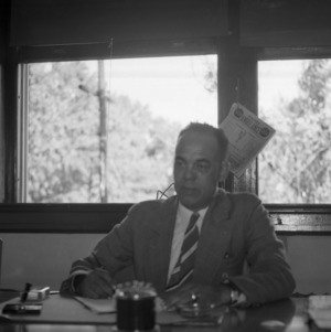 African American State Agent John W. Mitchell at desk