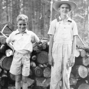 Calvin Boseman and his younger brother standing by harvest from Calvin's timber thinning demonstration