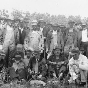 Black walnut cracking demonstration at farm of W.T. Bumgarner, Clay County