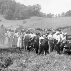 Farmers studying the installation of a hydraulic ram at the farm of Grover J. Abel, while on the Haywood County Farm Tour, 1938