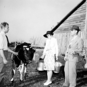 Farm agent J. E. Zimmerman with J. C. Turner and wife on their farm
