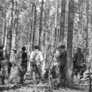 Farmers at a meeting on woodland management