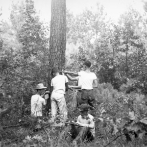 Boys practice measuring timber at Forestry Camp for Farm Boys