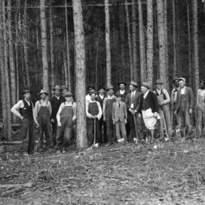 Group photo of men in forest