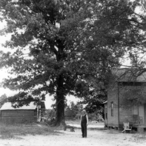 Agent T.J.W. Broom in front of tree