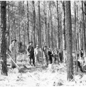 Men cutting pulpwood at demonstration