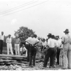 Lumbermen and sawmill operators at lumber stacking
