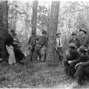 Farmers and foresters studying selective cutting and pine timber utilization