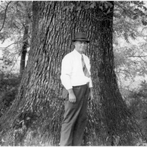County agent in front of large white oak