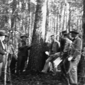 Carl W. Strauss demonstrating timber scaling for farmers